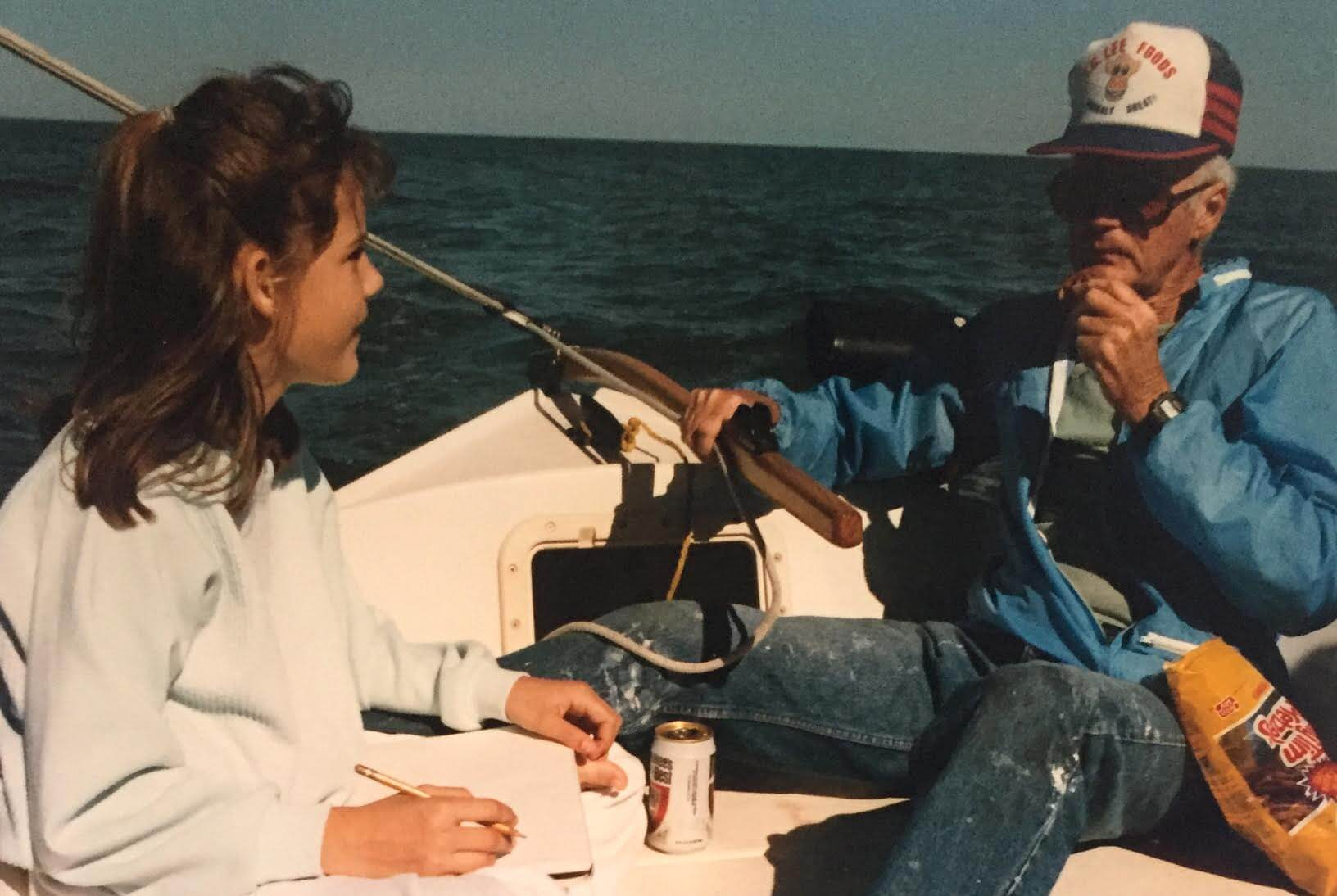 If you dream it, it will happen: A girl sitting in a sailboat together with her father