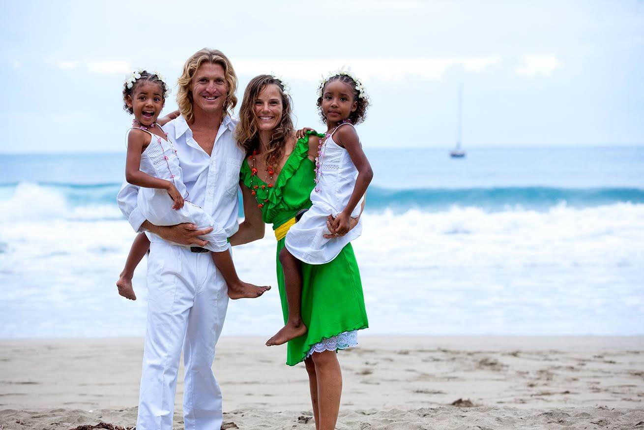 If you dream it, it will happen: a family of four standing on the beach and smiling