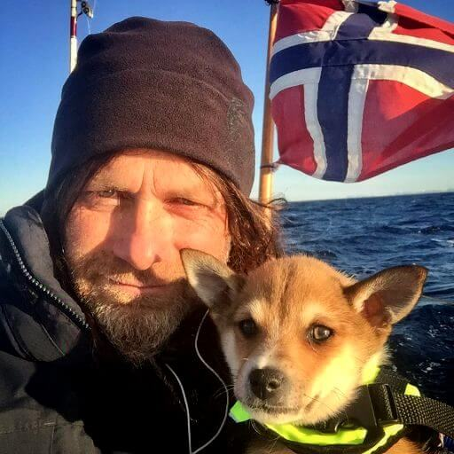 Norwegian sailor Leo together with his dog on a sailboat