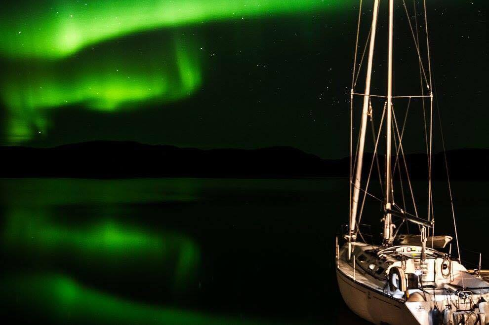 Sailboat with northern lights in the background