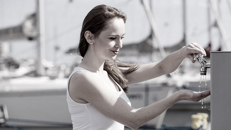 Woman washing hands in marina